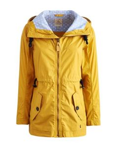 Joules Womens Coat, Gold.                     If you like to be beside the seaside, then this is the jacket for you. Inspired by days treading coastal paths, it's a great balance of form and function. We couldn't resist adding a spotty lining to increase the style of this showerproof essential.