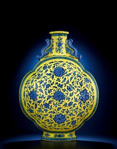 A very rare large yellow-ground blue and white quatrefoil Moonflask,Yongzheng six-character sealmark and of the period (1723-1735)  @ Christie's