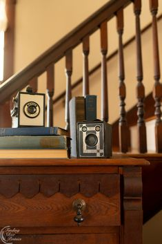 Decorating with old cameras | Finding Silver Pennies #vintage #homedecor #antiqueinspiration #stylinginspiration #hygge #cozyliving Old Cameras, Vintage Cameras, Amber Bottles, Living Styles, Geometric Wallpaper, Pottery Making, Glass Candle Holders, Finding A House, Vintage Decor