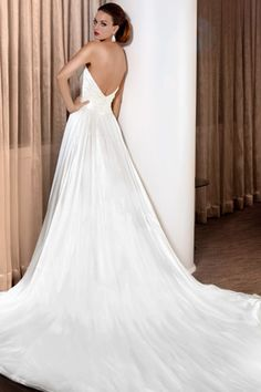 Strapless wedding gown with pleated satin bust