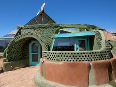 "Michael Reynolds explains ""Earthship Biotecture"" on the Green Majority, CIUT 89. Description from wn.com. I searched for this on bing.com/images"