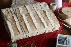 """#DIY tissue crepe paper streamers become ruffles when sewn onto kraft paper  in """"Handmade Holiday: Woodland Wrapping No. 2"""" 
