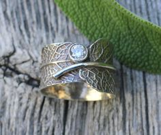 Engraved sage leaf. This is. Everything. With a different stone.... and probably not silver... I just love the concept.