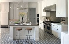 Stainless steel accents — not to mention an eye-catching floor — take designer Penny Drue Baird's pale gray pick over the top. Click through for more kitchen paint colors and kitchen decorating ideas. Cool Kitchens, Kitchen Colors, Kitchen Remodel, Kitchen Decor, Modern Kitchen, Home Kitchens, Kitchen Paint Colors, Kitchen Design, Kitchen Paint
