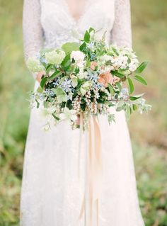 Soft blue, peach, and greenery wedding bouquet: http://www.stylemepretty.com/little-black-book-blog/2016/09/02/blue-gold-fall-wedding-inspiration/ Photography: Andy Barnhart - http://www.andybarnhart.com/