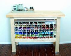 Rectangular rain gutters to organize glass rods used for lampworking.  Cabinet from Ikea.  Picture from Heather Sellers' studio.