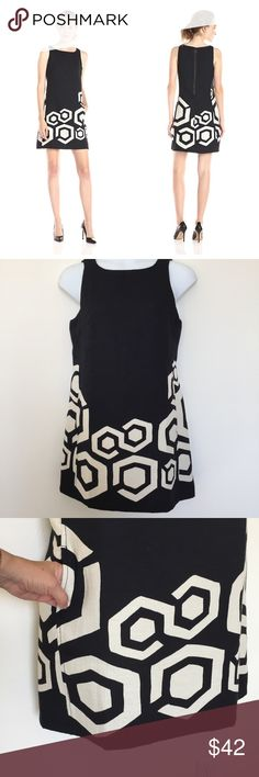 """Desigual Blk & White Sleeveless Asha Dress w/ pkts Sleeveless black and white dress with fun hidden pockets (see pic).  Such a fun dress! Can be worn with black opaque tights for a fall look or skip the tights and wear with black Wedge sandals for warmer days.  62% polyester 38% cotton.  Lining 100% polyester. The white fabric has little tiny punctures to add more pattern on the geometric designs.  Tag Size 44.  Measurements; chest 38"""", waist 37"""", hips 42"""", length 35"""", arm opening 9.5""""…"""
