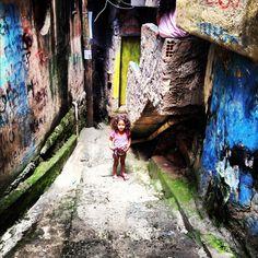 Travel guide: Favela Rocinha, Rio de Janeiro A little girl plays in the narrow streets of Rocinha. #rio #brazil