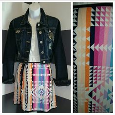"""Aztec print skirt NWOT Brand new! OH so fun and playful skirt. Pair this beauty with a white shirt and denim jacket and you are set!!  Aztec print multi colored skirt Blue trim and small slit pic#3  100%polyester Zips up on side. NWOT No material or size tag attached Length approx 17"""" Waist seam to seam approximately 13"""" Light weight skirt  No trades Price is firm unless bundled Skirts"""