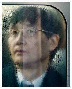 Michael Wolf's Tokyo Compression. People in the subway trains of the Japanese capital. An emotional collection of commuting individuals, with each portrait telling a unique story.