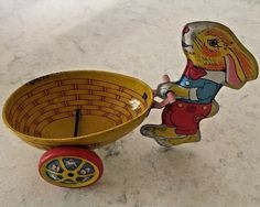 ANTIQUE TIN RABBIT PUSHING EAGG ON WHEELS BY CHIEN #Chein