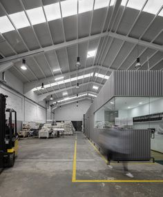 Image 19 of 27 from gallery of Renewal and new additions to industrial building / Photograph by Fernando Guerra Warehouse Shelving, Warehouse Office, Warehouse Design, Industrial Sheds, Industrial Office, Metal Building Homes, Building A House, Shed Office, Factory Architecture