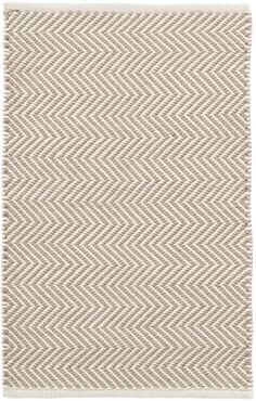 Grey days are no match for this peppy indoor/outdoor rug featuring a grey and ivory zigzag pattern. The thickest of our PET rugs, this durable, easy-care area rug provides geometric interest from the front porch to the back patio and everywhere in between.Made of 100% PET, a polyester fiber made from recycled plastic bottles.In order to achieve its rustic charm, this rug has been woven with large-diameter yarns. Consequently, slubs, knots, and other imperfections inherent to the…