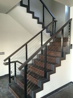 Black aluminum interior staircase cable railing system by Stainless Cable & Railing // photo sent in by customer Bob Schneider