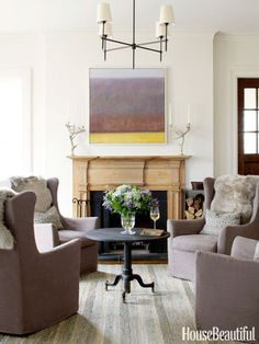 Swivel chairs topped with sheepskin pelts in a family room