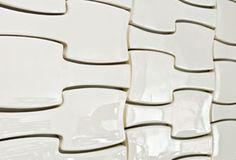 Modcraft - Porcelain wall tiles  David Clark's interlocking porcelain wall tiles by Modcraft, 718-541-1160; mod-craft.com.