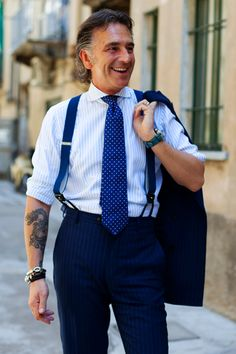 Tough yet Chic: I really love a man that is well dressed with a tough side peaking through (tattoo). via sartorialist