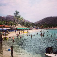 """This beach in Zihuatanejo, Mexico has a signt that says ~ """"Leave nothing but footprints. Take nothing but pictures. Kill nothing but time."""" A wonderful daily reminder to life. And I really want to go to this beach!"""
