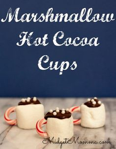 Marshmallow Hot Cocoa Cups are an easy way to get in the holiday spirit and they make great christmas party treats and  they can be used as holiday party decorations that you can eat too! Using the BIG marshmallows, melted chocolate and candy canes these are not only adorable, but they taste great too!!