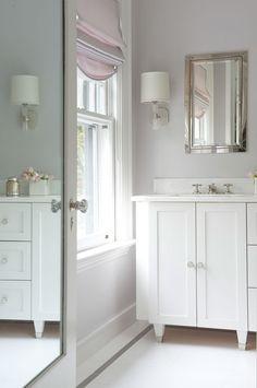Elegant small bathroom using mirrors to expand - Laura Tutun Interiors