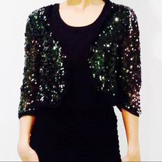 Cute sequin cardigan Brand new. Dark sequin cardigan in forest green. So cute and lightweight. Perfect to just throw over any outfit. 3/4 length sleeve. (S,m,l) Tops