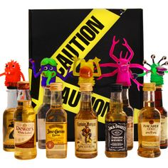Caution Crazy Monster Crossing Mini Bar Gift Set: Product Code: S13091309  Proceed with Caution! It's a Crazy #Monster Crossing.  Black Caution box filled with 10 assorted mini bar bottles (50ml each) and topped with 5 colorful Monster Finger Puppets. 5 Monster Finger Puppets #Captain Morgan #Jack Daniels #Dewars #Bacardi Gold #Shellback  and More!  #halloween #gift