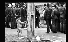 After the battle of Walters Rd, a small boy paints a peace sign. Third Springbok test, Eden Park 1981. John Selkirk