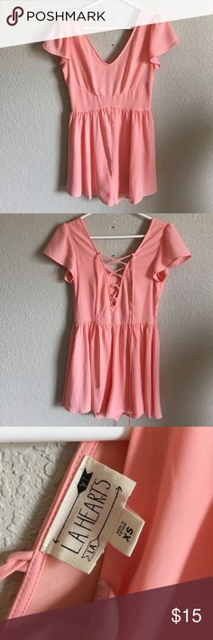 Strappy Pink Romper (40) The cutest candy pink romper with fluttery sleeves and a trendy back. Only flaw is the tear by the zipper which can be fixed. Tag size XS. Bust- 16 inches Waist- 13.5 inches Length- 29 inches LA Hearts Pants Jumpsuits & Rompers
