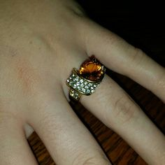 Fashion Jewelry Ring Has a little discoloration that you can see in the last picture. Otherwise in good condition. Jewelry Rings