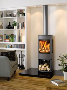 Dovre Astroline 4 Stove Multi-fuel Stove with wood store. Buy Dovre Astroline 4 Stove from authorised Dovre Stove UK Retailers. Log Burner Living Room, Log Burner Fireplace, Wood Burner, My Living Room, Gas Log Burner, Fireplace Shelves, Modern Fireplace, Fireplace Design, Modern Log Burners