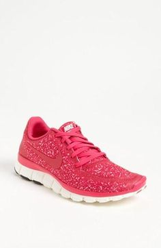 Pink animal print Nike running shoes; pink and animal print, AND Nike?? These were meant for me!!