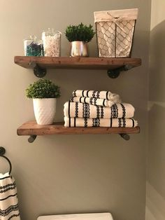 $60.99 · Floating shelves add a rustic but contemporary look to your home or work space. The handcrafted, solid wood shelves and sleek iron pipe supports provide sturdy storage for books, dishes, or bathroom décor in a cozy, farmhouse style. #rustichomedesign #diyrustic