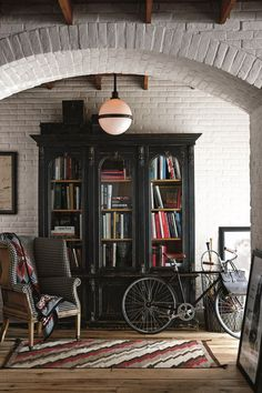 A perfect reading nook, with the vintage-inspired Ralph Lauren Home Victorian Bookcase alongside the Hepplewhite Wing Chair