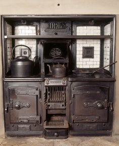 Trident kitchen range installed in the still-room at Dunham Massey, supplied by Clement Jeakes during the modernisation of 1906, shows two k...