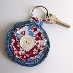 Upcycle denim keychain from scrap fabric. Great as a Christmas gift or stocking - Sale! Shop at Stylizio for womens and mens designer handbags luxury sunglasses watches jewelry purses wallets clothes underwear more! Jean Crafts, Denim Crafts, Artisanats Denim, Denim Purse, Denim Ideas, Recycle Jeans, Fabric Jewelry, Fabric Scraps, Scrap Fabric
