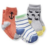 An anchor, nautical stripes and cute whale make these themed socks so fun to wear!