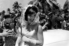First lady Jacqueline Kennedy smiles as she leaves a private Easter service at the Kennedy family home in Palm Beach on April 14, 1963. (AP Photo)