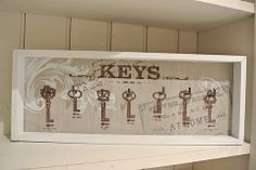 Framed Key Hook Wall Mount - Divine Shabby Chic This handy key hook mount comes with on a vintage backdrop with a white frame  Wall mounts to back for easy hanging  Seven hooks for all house hold keys  Measures 41x16 cm approx.  White mount has shabby chic edge work      Was £10.50 Now £7.88