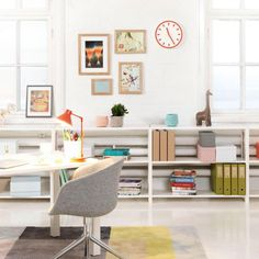 a colorful workspace - i love the low shelving along the wall