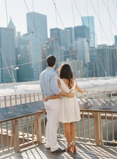 { BROOKLYN BRIDGE ENGAGEMENT PHOTOS } ..... We are drooling over these heart-stoppingly beautiful Brooklyn Bridge engagement photos from Carmen Santorelli! Chris and Natalie chose a classic NYC theme for their upcoming Central Park wedding and decided that the iconic Brooklyn Bridge would be the perfect backdrop for their engagement session! They strolled the bridge and the Brooklyn Heights Promenade on a gorgeous late-summer day, hand in hand.