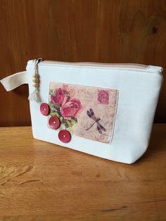 Handmade Victorian Post Card Cosmetic Purse by EverSewNice on Etsy https://www.etsy.com/listing/271857250/handmade-victorian-post-card-cosmetic