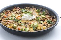 Delicious and easy one pan meal! Low carb Mexican Cauliflower Rice Skillet.