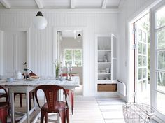 North of Copenhagen a young couple created a small white house that contains a family room and a bedroom with antique furniture. This house also has a pretty terrace that is covered and could be used even in rainy days.