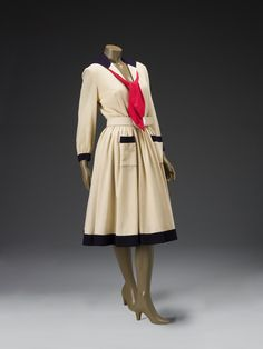 day dress  artist Norell, Norman American 1900-1972  creation date about 1947  materials wool crepe, mother-of-pearl (belt)  Norman Norell  The sailor dress appeared in a myriad of variations throughout Norell's career. As a child he was often dressed in sailor suits and even had his portrait painted in one of them. Throughout the 1950s and 1960s, Norell continued to use nautical details for both day and evening wear, an homage to his pleasant childhood memories.