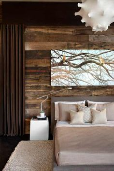 Obsessed with the rustic wood on the bedroom walls.