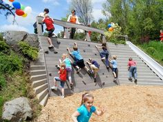 climbing wall, vertical steps, slide and mini fort at ground level above the climbing wall NaturalPlaygrounds.com out of NH