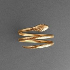 We're enraptured with this vintage gold-fill wrap bracelet, as sleek and slinky as a snake. #etsyfinds