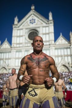 Players from the Santo Spirito Bianchi team prepare for the final of the Calcio Storico in Florence, Italy.