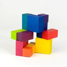 Explore your inner architect with this colorful wooden cube that can be manipulated in hundreds of forms from streamlined to complex. Sturdy elastic holds the pieces together so there are no parts to lose, making it ideal for travel.  There is no puzzle to solve -- the goal is maximum creativity.  Made from solid maple with non-toxic dyes.  Ages 6+