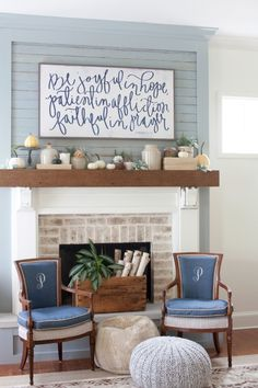 Ship lap/tongue & groove wall above fireplace. White color. Dark walnut mantle shelf & white wash brick